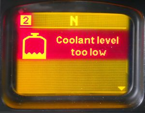 The coolant level is very low or the coolant level sensor is faulty.