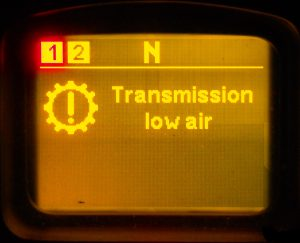 Transmission warning. Low air pressure in the transmission control system. If a red warning appears during driving, the AS-TRONIC gearbox may remain on the current gear. Immediately after stopping the car, the gearbox switches to neutral and no further movement is possible.